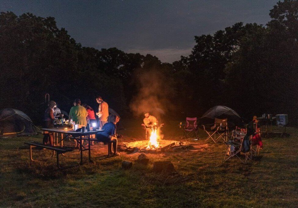 Camping in Austin near a campfire